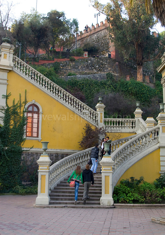 "Romantic couples climb the stairs on Santa Lucía Hill (Spanish: Cerro Santa Lucía) is a small hill in central downtown Santiago, Chile. Beside it runs Alameda del Libertador Bernardo O'Higgins. Santa Lucia Hill has an altitude of 629 m and a height of 69 m. Benjamín Vicuña Mackenna decided to conduct a dramatic change to the urban atmosphere of the city of Santiago, among his many works aimed to improve the city, and thus initiated the construction of the garden.......Clled Huelén by the pre-colonization inhabitants; in the Mapudungun language it apparently meanss ""pain, melancholy or sadness"" relating to the act of capturing the hill by Pedro de Valdivia on December 13, 1541. ....Editorial Use Only"