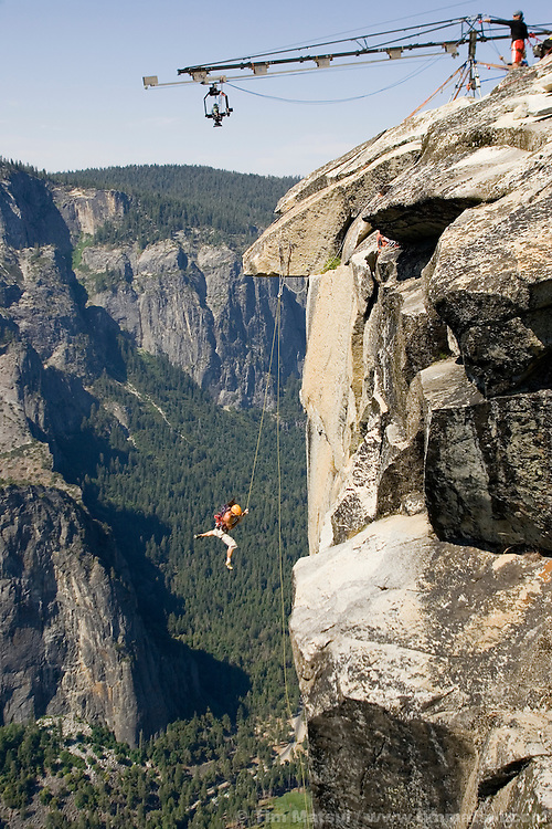 Athlete Alex Huber, belayed by his brother Thomas, re-enacts a fall from a dream sequence Thomas had while on top of El Capitan for the filming of Am Limit, a Lotus Film production, about the climbing brothers Alexander and Thomas Huber and their attempt to break the speed climbing record on the Nose of El Capitan in Yosemite National Park, California, USA.