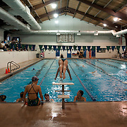 A swimmer enters the pool from starting blocks during a charity event to raise money for Alfred I. Dupont Hospital for Children.