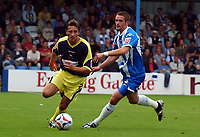 Photo: Olly Greenwood.<br />Colchester United v Derby County. Coca Cola Championship. 26/08/2006. Derbys Tommy Smith and Colchesters Greg Halford