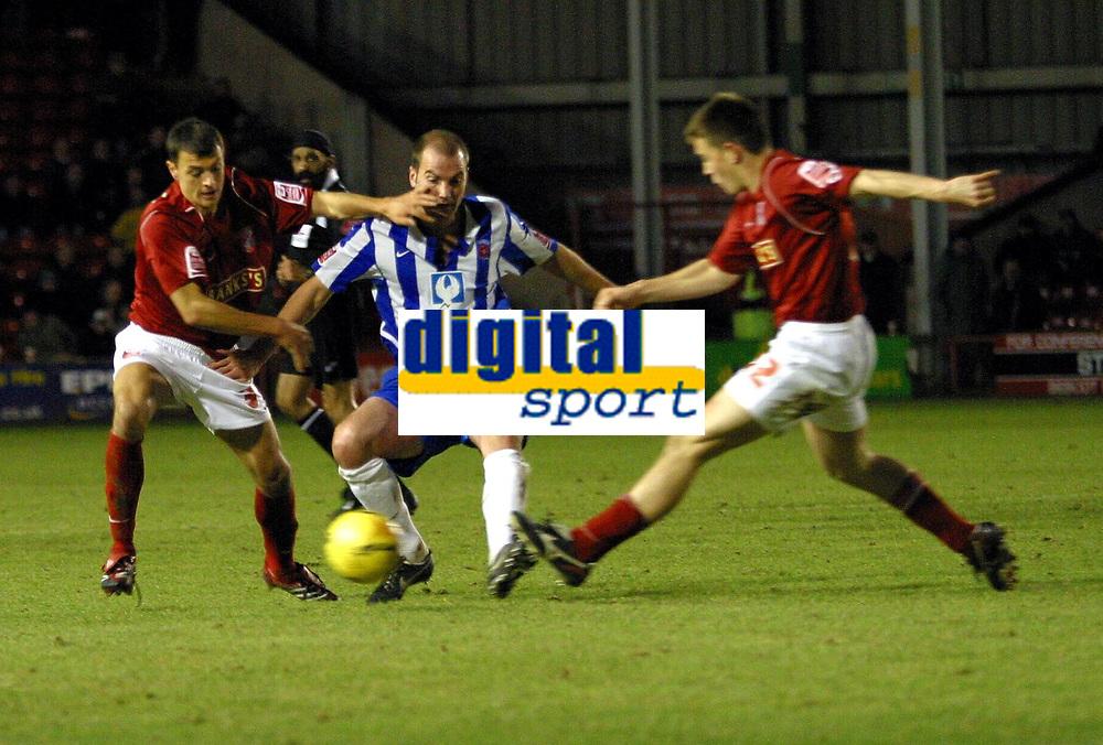 Photo: Dave Linney.<br />Walsall v Hartlepool United. Coca Cola League 1. 17/12/2005. Ben Clarke(Hartlepool) keeps Alex Nicholls/left & Matty Fryatt (Walsall) ay bay.