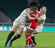 Emily Scarratt and Rachael Burford tackle Magali Harvey, England Women v Canada Women in an Old Mutual Wealth Series, Autumn International match at Twickenham Stadium, London, England, on 26th November 2016. Full time score 39-6