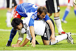 Erdar Tasci of Germany and Marco Ritzberger of Liechtenstein get in a tangle during the match between Germany and Liechtenstein, Leipzig, Germany. 28th March 2009.<br /> <br /> UK ONLY