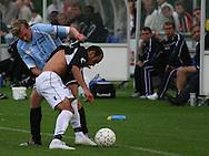Christoffer Thaysen (Elite 3000) har fat i Alex da Silva (Randers FC).
