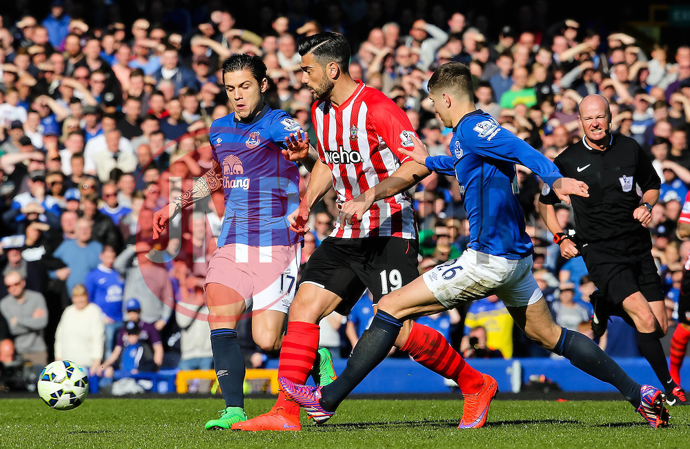 Southampton's Graziano Pelle is tackled bt Everton's Muhamed Besic and John Stones - Photo mandatory by-line: Matt McNulty/JMP - Mobile: 07966 386802 - 04/04/2015 - SPORT - Football - Liverpool - Goodison Park - Everton v Southampton - Barclays Premier League