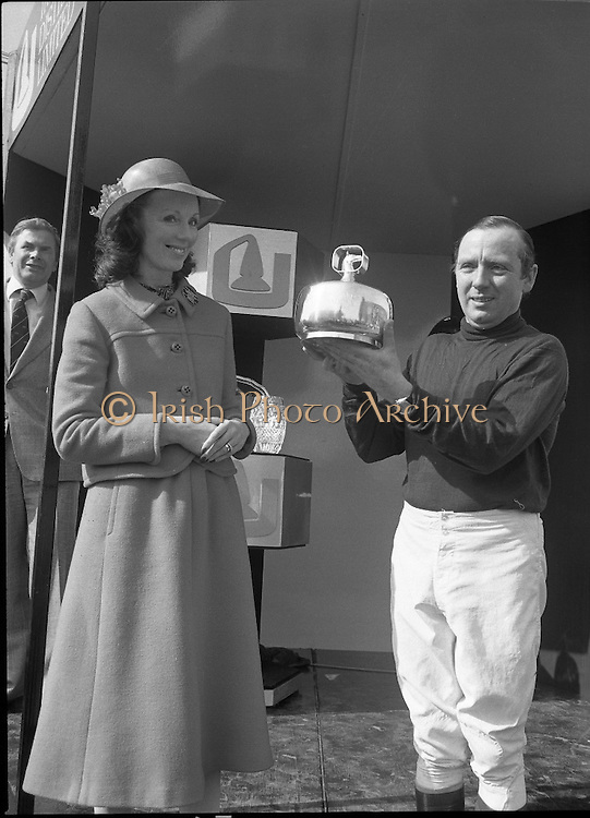 "Irish Distillers Grand National at Fairyhouse.  (M66)..1979..16.04.1979..04.16.1979..16th April 1979..The Irish Distillers Grand National was run today at Fairyhouse Racecourse, Co Meath.The race over 3.5miles is valued at £20,000. the winning trainer will also receive the Tom Dreaper,Perpetual Trophy which will be presented by Mrs Betty Dreaper..Picture of winning owner and rider of ""Tied Cottage"", Mr Anthony Robinson accepting his trophy from Mrs Michael O'Kennedy."