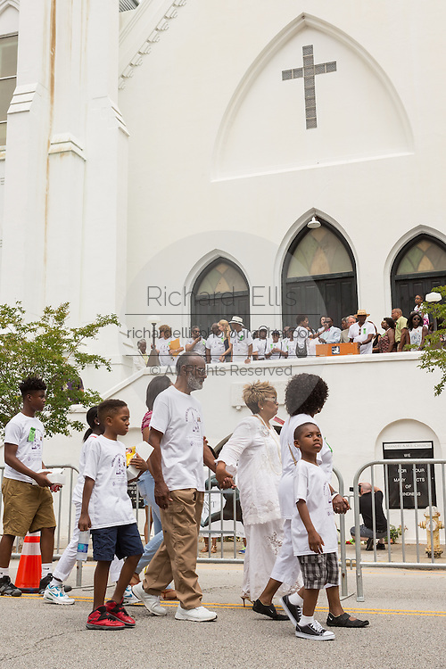 Family members of the Charleston Nine gather at the front of the Mother Emanuel African Methodist Episcopal Church for a memorial service on the anniversary of the mass shooting June 18, 2016 in Charleston, South Carolina. Nine members of the church community were gunned down during bible study inside the church on June 17, 2015.