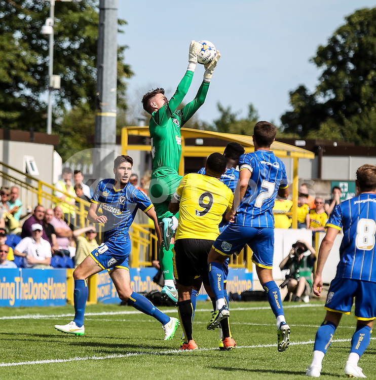 Joe McDonnell of AFC Wimbledon catches during the Pre-season Friendly match between AFC Wimbledon and Watford at the Cherry Red Records Stadium, Kingston, England on 11 July 2015. Photo by Ken Sparks.