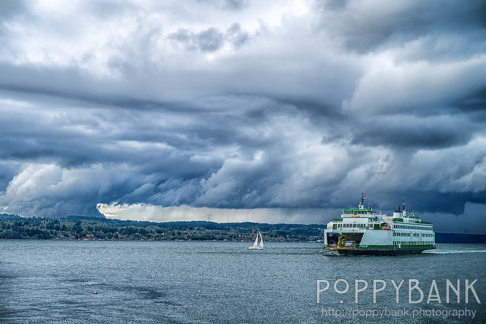 A storm rolls across Whidbey Island as the Cathlamet ferry arrives at the Mukilteo ferry terminal.  This storm would soon spawn a waterspout in Tulalip Bay