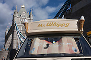A Mr Whippy ice cream van is parked beneath the tall Tower Bridge, on the southern borough of Southwark side.