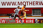 Hearts FC Forward Osman Sow and Motherwell FC Defender Keiran Kennedy battle  during the Ladbrokes Scottish Premiership match between Motherwell and Heart of Midlothian at Fir Park, Motherwell, Scotland on 28 November 2015. Photo by Craig McAllister.