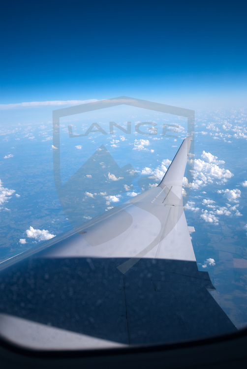 airplane wing and sky while flying between albuquerque, new mexico, and houston texas enroute to rio de janeiro brazil.