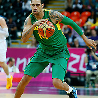 06 August 2012: Brazil Marquinhos Vieira Sousa brings the ball upcourt during 88-82 Team Brazil victory over Team Spain, during the men's basketball preliminary, at the Basketball Arena, in London, Great Britain.