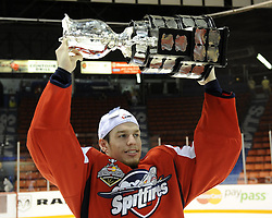 Stephen Johnston of the Windsor Spitfires hoists the Memorial Cup after  the championship game of the 2010 MasterCard Memorial Cup in Brandon, MB on Sunday May 23. Photo by Aaron Bell/CHL Images