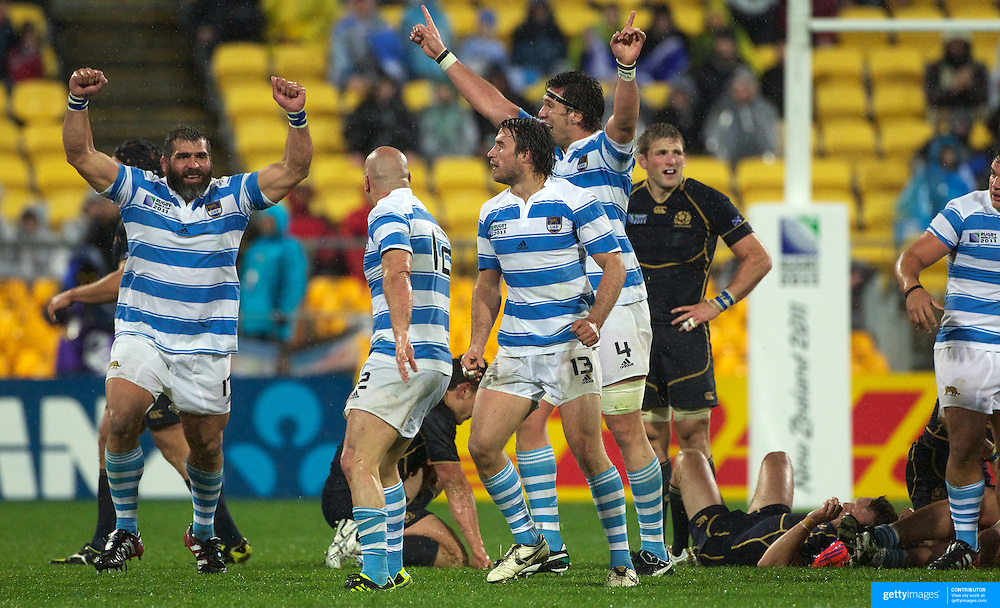 Jubilation for Argentina and dejection for Scotland as Argentina celebrate their 13-12 during the Argentina V Scotland, Pool B match at the IRB Rugby World Cup tournament. Wellington Regional Stadium, Wellington, New Zealand, 25th September 2011. Photo Tim Clayton...