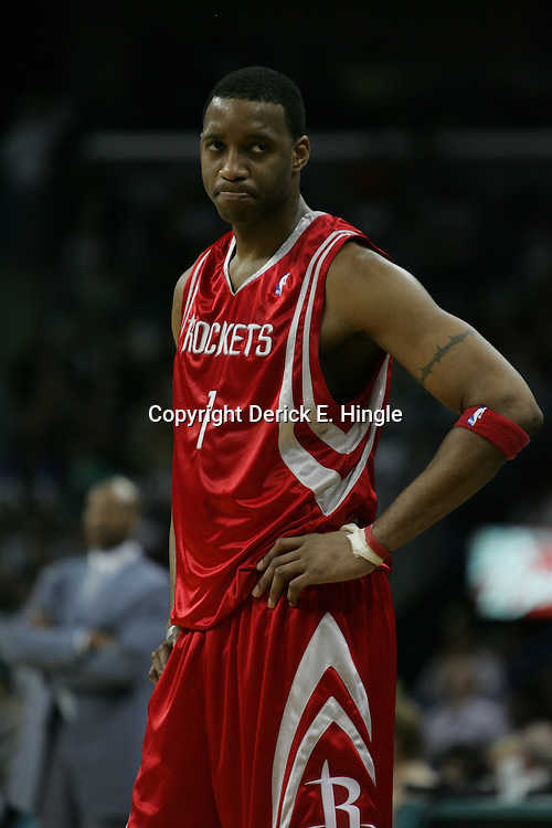 Tracy McGrady #1 of the Houston Rockets looks on in disappointment in the final moments of the fourth quarter of the Rockets 90-69 loss to the New Orleans Hornets on March 19, 2008 at the New Orleans Arena in New Orleans, Louisiana.