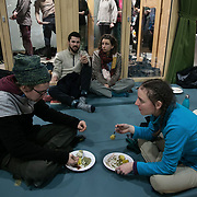 The second day of the Strike WEF march on Davos, 20th of January 2020, Switzerland. People eat and relax after the long walk in Klosters Arena. The march started in Schiers and walked the 24 kilomers to Klosters.  The aim is to finish in Davos with a public meeting in the town on the day the WEF begins. The march is a three day protest against the World Economic Forum meeting in Davos. The activists want climate justice and think that The WEF is for the world's richest and political elite only.