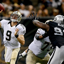 Aug 16, 2013; New Orleans, LA, USA; New Orleans Saints quarterback Drew Brees (9) throws against the Oakland Raiders during the second quarter of a preseason game at the Mercedes-Benz Superdome. Mandatory Credit: Derick E. Hingle-USA TODAY Sports