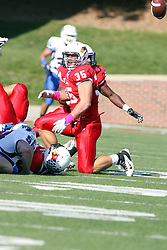 22 October 2011: the ball spurts from the hands of Austin Davis as he is tackled.  Mike Banks sees the ball but Colton Underwood does not during an NCAA football game  the Indiana State Sycamores lost to the Illinois State Redbirds (ISU) 17-14 at Hancock Stadium in Normal Illinois.