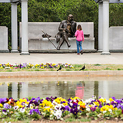 A small girl walks up to the statue of George Mason at the George Mason Memorial in Washington DC in Potomac Park near the Jefferson Memorial. The memorial honors one of the lesser known Founding Fathers.