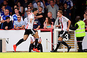 Brentford defender John Egan (14)  celebrating scoring with Brentford midfielder Lewis Macleod (4) 1-0 during the EFL Sky Bet Championship match between Brentford and Ipswich Town at Griffin Park, London, England on 13 August 2016. Photo by Matthew Redman.