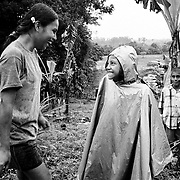 Two young friends working on a small holding farm growing alternative crops. The farm is surrounded by coca plantations. The Government uses ariel fumigation to destroy the coca plants, the chemicals are often carried by the wind or leach through the ground and destroy all crops in the area.<br />