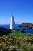 White stone navigation beacon at the entrance to Baltimore harbour, County Cork, Ireland