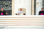 Pope Francis delivers a speech during his weekly general audience in St Peter's square at the Vatican on May 09, 2018.