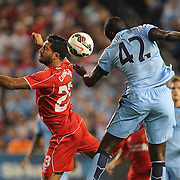 Emre Can, (left), Liverpool, challenges Yaya Touré, Manchester City during the Manchester City Vs Liverpool FC Guinness International Champions Cup match at Yankee Stadium, The Bronx, New York, USA. 30th July 2014. Photo Tim Clayton