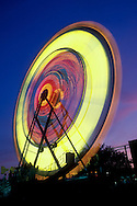 Light trails of ferris wheel as it rotates in this long exposure image at the Monmouth County Fair in Freehold, NJ. July 1989.