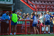 Ini Umotong (Brighton), Aileen Whelan (Brighton) & Megan Connolly (Brighton) signing autographs and talking with young supporters following the FA Women's Super League match between Brighton and Hove Albion Women and Chelsea at The People's Pension Stadium, Crawley, England on 15 September 2019.