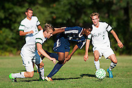 Burlington's Peter Makuni (14) runs between Rice's Evan rouleau (7) and Loius Gazo (8) with the ball during the boys soccer game between the The Burlington Seahorses and the Rice Green Knights at Rice Memorial high School on Tuesday afternoon September 15, 2015 in South Burlington, Vermont. (BRIAN JENKINS/for the FREE PRESS)