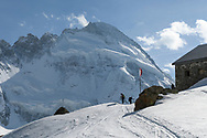 Two alpinists are ascending to the Schönbielhütte, north face of the Dent d'Herens, Valais, Switzerland