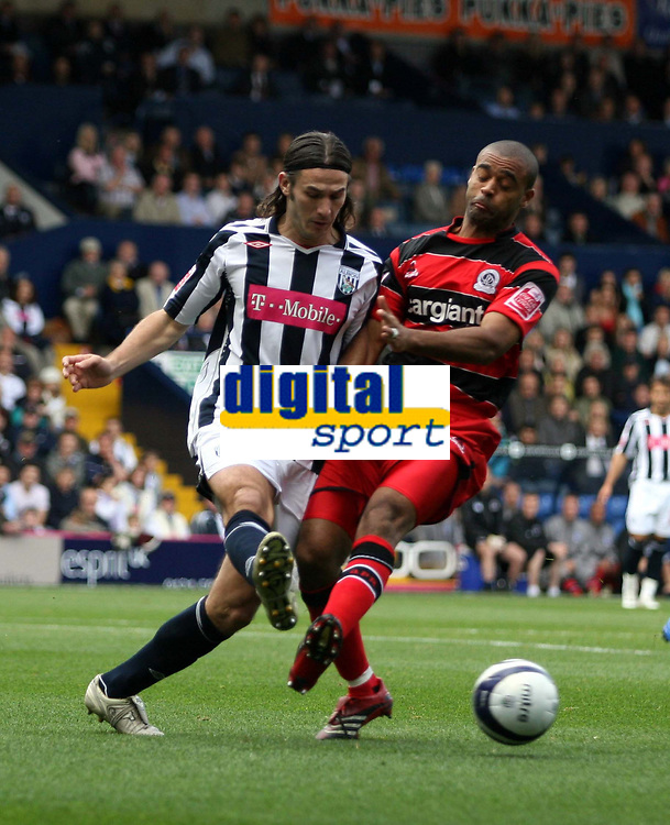 Photo: Mark Stephenson.<br /> West Bromwich Albion v Queens Park Rangers. Coca Cola Championship. 30/09/2007.West Brom's Carl Hoefkens  (L) and Qor's Stefan Moore