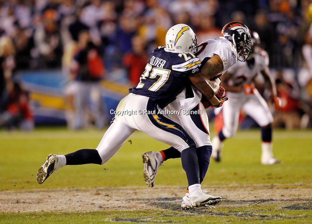 Denver Broncos wide receiver Jabar Gaffney (10) catches a pass and gets tackled in the second quarter by San Diego Chargers safety Paul Oliver (27) during the NFL week 11 football game against the San Diego Chargers on Monday, November 22, 2010 in San Diego, California. The Chargers won the game 35-14. (©Paul Anthony Spinelli)