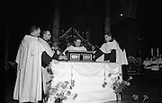 St Valentine Commemorated..1968..14.02.1968..02.14.1968..14th February 1968..On St Valentine's Day, the remains of the saint, which are kept in the Carmelite Church in Whitefriar Street, Dublin, are taken from the shrine to the high altar where a special Mass is celebrated.  ..Image shows the casket containing the remains of St Valentine being laid on the altar of Whitefriar Street, Church.