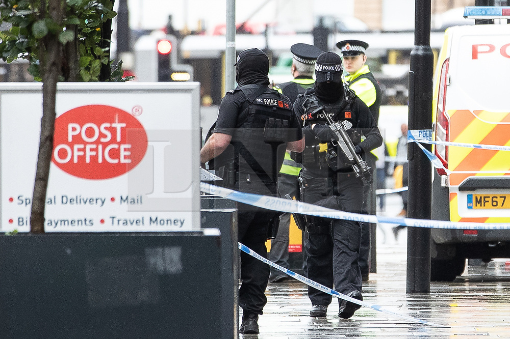 © Licensed to London News Pictures. 11/10/2019. Manchester, UK. Armed police respond at the scene . Terrorism Police are investigating after four people were stabbed during a single attack at the Arndale Centre in Manchester City Centre . Photo credit: Joel Goodman/LNP