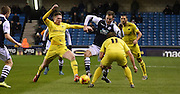 Jed Wallace looks to break through the Oxford defence during the Johnstone's Paint Trophy semi final first leg match between Millwall and Oxford United at The Den, London, England on 14 January 2016. Photo by Michael Hulf.