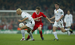 CARDIFF, WALES - Sunday, March 2, 2003: Liverpool's Michael Owen take on Manchester United's Rio Ferdinand during the Football League Cup Final at the Millennium Stadium. (Pic by David Rawcliffe/Propaganda)