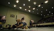 Corpus Christi King High School's Josh Garza battles Adam Hill of Cedar Park High School during the boys' finals of the Region IV wrestling tournament at Littleton Gymnasium on Saturday, Feb. 11, 2012. Hill won to secure the 195 lb. championship.