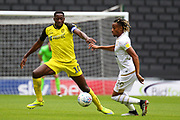 Burton Albion forward Lucas Akins stretches for the ball during the EFL Sky Bet League 1 match between Milton Keynes Dons and Burton Albion at stadium:mk, Milton Keynes, England on 5 October 2019.