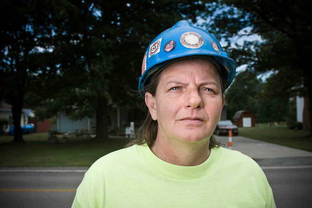 Construction worker Connie Kincaid hasn't worn her hard hat on a job site in months. Photographed at her Grafton, OH home on July 15, 2009. (Photo/Jason Miller)