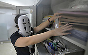 Feeling hen-pecked? Chinese company allows staff to wear masks at work to help them deal with stress<br /> <br /> A company in Hangzhou, eastern China, has allowed its staff to wear masks at work to help them feel more confident while dealing with demanding bosses.<br /> <br /> Employees were seen donning various kinds of headgears, which ranged from a Venetian mask to a quirky hen-shaped mask, on the company's 'De-stress Day' last week.<br /> <br /> Managers of the firm hope the novel idea can help staff feel more relaxed at work, especially when they are required to present ideas in front of colleagues and supervisors<br /> <br /> The unusual scene was captured on September 23 in Songcheng Performance Development Company, which operates a large movie theme park in Zhejiang province.<br /> <br /> All staff were allowed to wear headdresses of their choices when they worked at desk and attended meetings.<br /> <br /> It is thought masks can conceal employees' emotion, thus make them feel more comfortable while speaking up in front of colleagues and supervisors.<br /> <br /> In addition, for junior employees, they were more likely to share opinions because they wouldn't recognise their bosses.<br /> <br /> A manager of the company confirm the thought. <br /> <br /> The unnamed manage told Chinese media that meetings were much more constructive on that day as employees appeared to be more outspoken behind masks. <br /> A pillow fight was also organised during the lunch hour to help staff reduce stress.<br /> <br /> <br /> The event organiser said: 'Through this activity, our employees could hopefully restore the balance between work and leisure.<br /> <br /> 'This can also help them reduce pressure at work.'<br /> The online community in China seemed to have divided opinion on the event.<br /> <br /> One Weibo user said: 'Why doesn't the company just give their employees another day off instead?'<br /> <br /> While another online user commented: 'It is quite good to hi