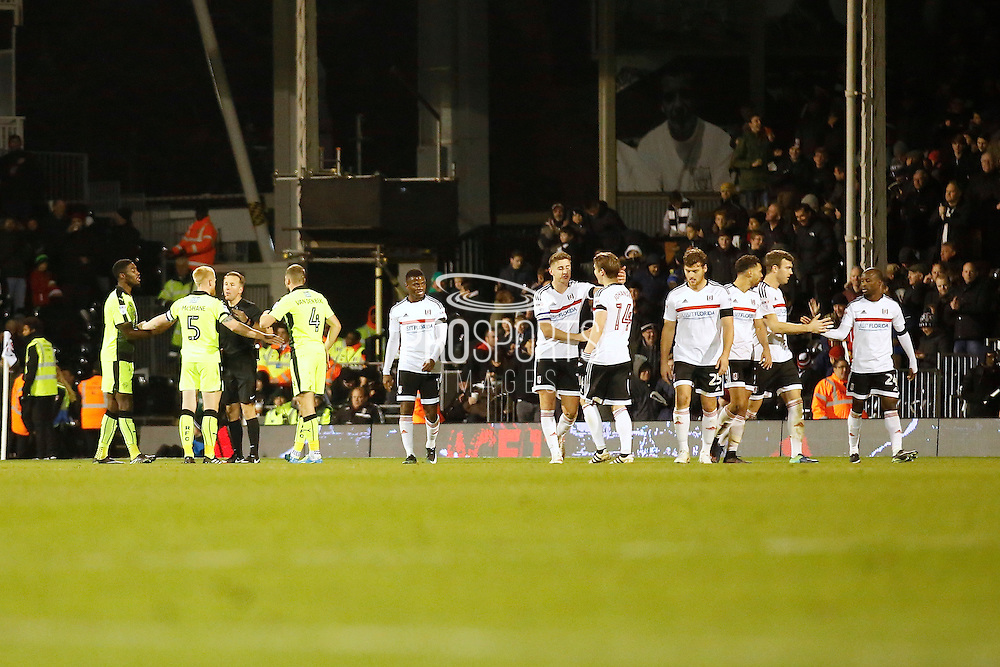 mixed emotions, Fulham FC celebrates a goal to make it 3-0. whilst Reading FC players protest to the match Referee Simon Hooper during the EFL Sky Bet Championship match between Fulham and Reading at Craven Cottage, London, England on 3 December 2016. Photo by Andy Walter.