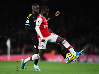 Football - 2019 / 2020 Premier League - Arsenal vs. Manchester City<br /> <br /> Arsenal's Nicolas Pepe holds off the challenge from Manchester City's Benjamin Mendy, at The Emirates.<br /> <br /> COLORSPORT/ASHLEY WESTERN