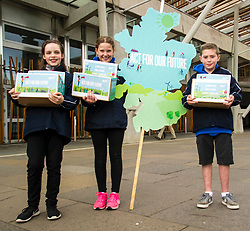 Pictured: Fay Turpie Laird (11), Lucy Beeston (pony tail 11)  and Sorley Scott (10)  protesting  for zero climate emmissions and asking for parliament to act for their future. <br /> <br /> Cabinet secretary for Environment, Climate Change and Land Reform, Roseanna Cunningham, MSP, joined pupils from Sceines Primary School outside the Scottish Parliament to support the campaign to reduce climate emissions to zero by 2050<br /> <br /> <br /> Ger Harley | EEm 20 September 2017