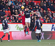 17th March 2018, Pittodrie Stadium, Aberdeen, Scotland; Scottish Premier League football, Aberdeen versus Dundee; Steven Caulker of Dundee competes in the air with Andrew Considine of Aberdeen