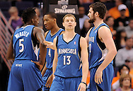 Mar. 12, 2012; Phoenix, AZ, USA;  Minnesota Timberwolves guard Luke Ridnour (13) reacts on the court with guard Martell Webster (5) , forward Wesley Johnson (4) and forward Kevin Love (42) while playing against the Phoenix Suns at the US Airways Center. The Timberwolves defeated the Suns 127-124.  Mandatory Credit: Jennifer Stewart-US PRESSWIRE.