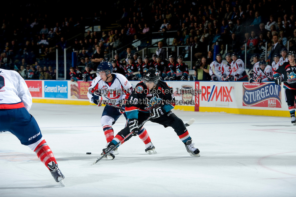 KELOWNA, CANADA, OCTOBER 16 -  Russell Maxwell #7 of the Lethbridge Hurricanes stick checks Nick Merkley #10 of the Kelowna Rockets on Wednesday, October 16, 2013 at Prospera Place in Kelowna, British Columbia (photo by Marissa Baecker/Getty Images)***Local Caption***