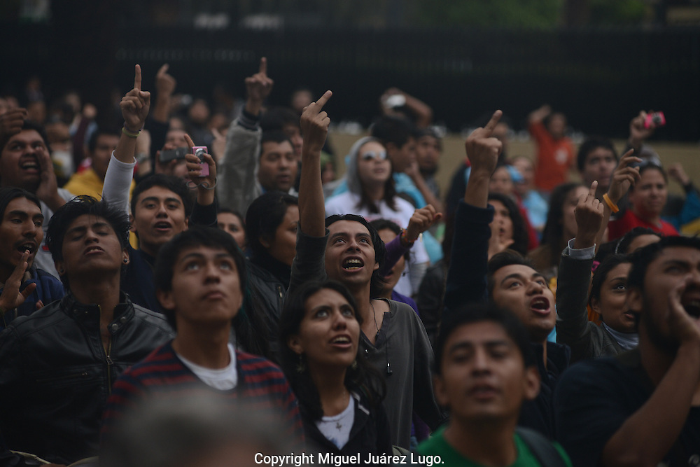 Mexico city.- Young people with Mexico's new #YoSoy132 movement, make some gestures toward the headquarters of the country's historic PRI party during a rally to protest the election of PRI presidential candidate Enrique Peña Nieto. (PHOTO: MIGUEL JUAREZ LUGO)